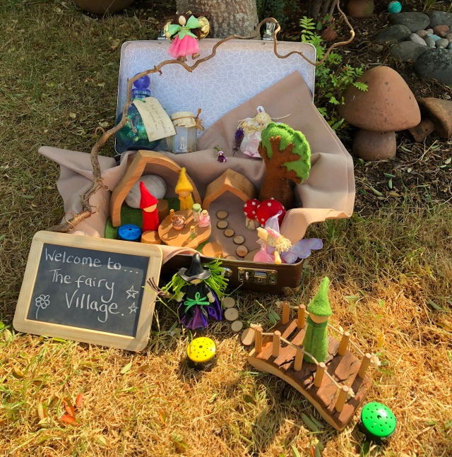 Inspiring Suitcases filled with exciting treasures to explore - a fairy village