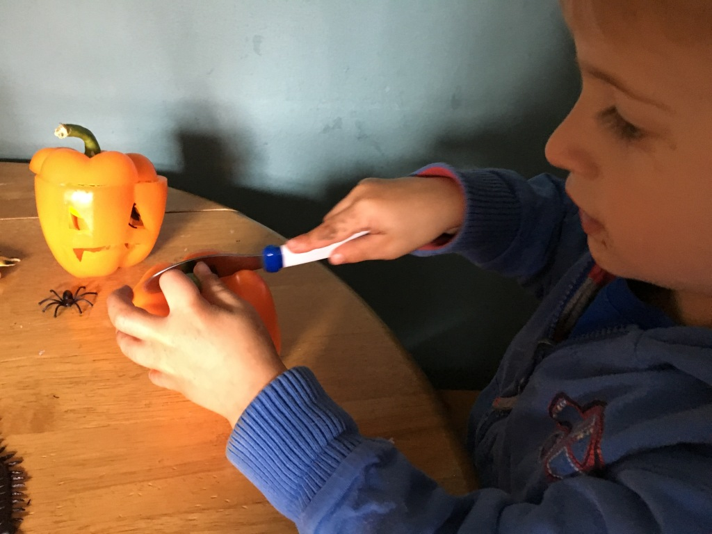 9 Halloween Craft Projects for Kids - orange pepper carving