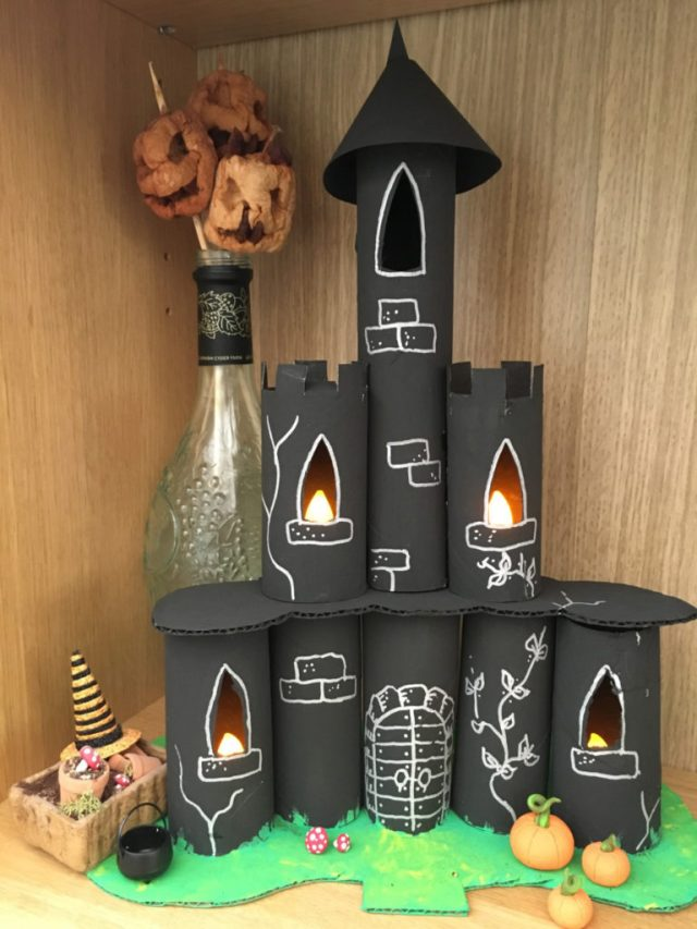 9 Halloween Craft Projects for Kids - recycled toilet roll tube spooky castle