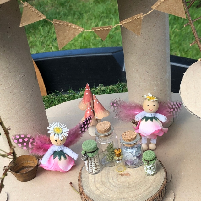 Fairy Small World Play in the Tuff Tray idea. With miniature fairies and potion bottles.